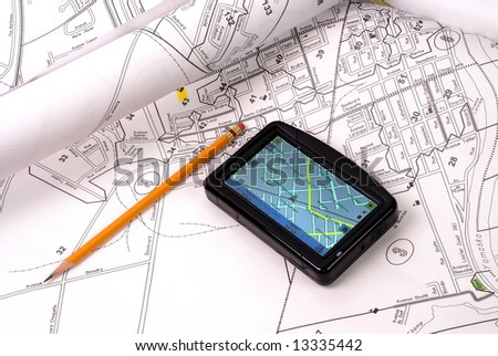 GPS on streets map and pencil - stock photo