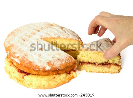 Grabbing a slice of the cake - stock photo