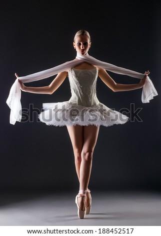 Graceful ballerina dancing looking at camera - stock photo