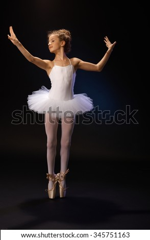 Graceful ballet dancer practicing classical ballet. - stock photo