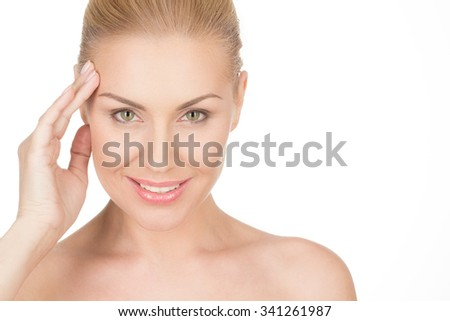 Graceful beauty. Cropped studio beauty shot of a smiling woman giving a confident look to the camera - stock photo