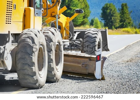 grader road construction - stock photo