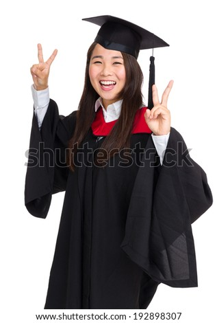 Graduate girl student showing victory sign - stock photo