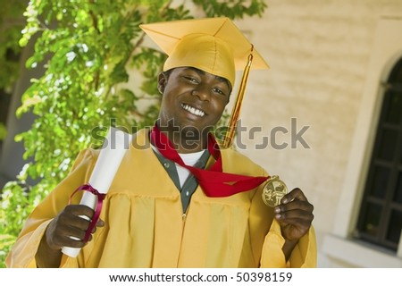 Graduate holding diploma and medal outside, portrait - stock photo
