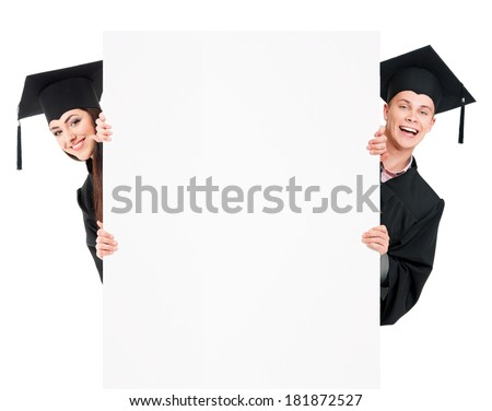 Graduate students in mantle showing blank placard board, isolated on white background - stock photo