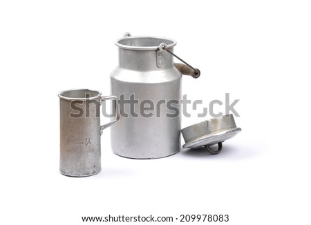 Graduated jug and milk can - stock photo