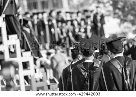 Graduates are walking in line to get your degree,graduation stand up,monochrome - stock photo