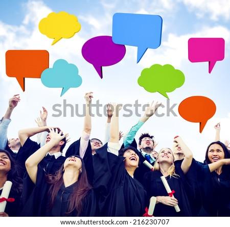 Graduates arms raised with speech bubbles. - stock photo