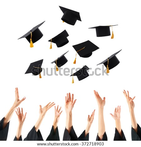 Graduates hands throwing graduation hats , isolated on white - stock photo
