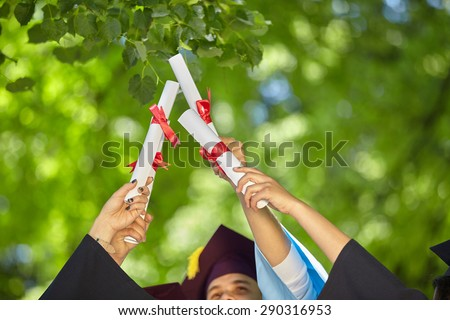 graduates stutents  throwing graduation hats in the air. - stock photo