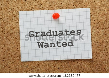Graduates Wanted typed on a piece of graph paper and pinned to a cork notice board - stock photo