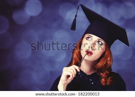 graduating student girl in an academic gown.  - stock photo