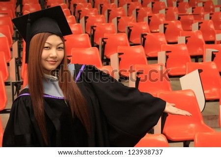 graduation asia women with degree suit in studying room - stock photo
