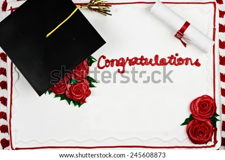 Graduation cake with school cap and tassel. Room for copy space. - stock photo