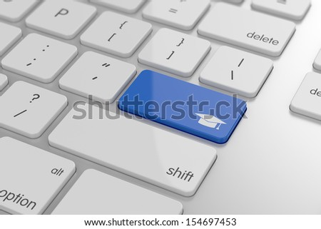 Graduation cap button on keyboard with soft focus  - stock photo