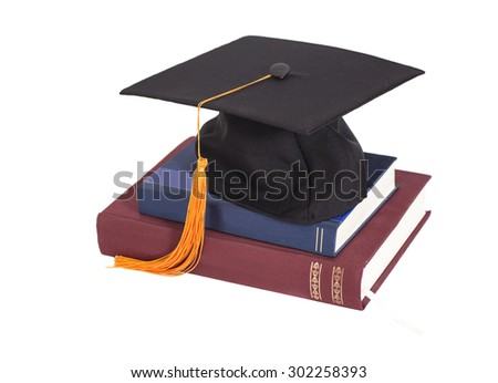 Graduation Cap On stuck of Books isolated - stock photo