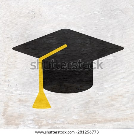 graduation cap on wood grain texture - stock photo