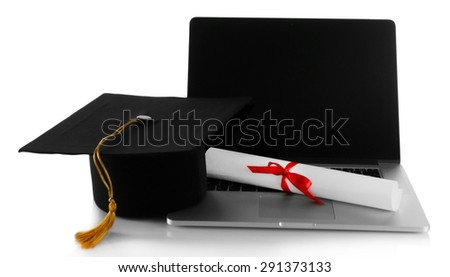 Graduation cap with laptop and diploma isolated on white - stock photo