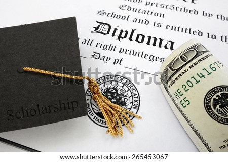 graduation cap with Scholarship text and money on a high school diploma                                - stock photo