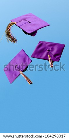 Graduation caps flying in the air after being thrown with room for copy - stock photo