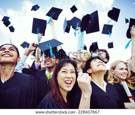Graduation Caps Thrown in the Air - stock photo