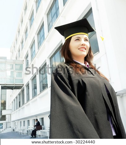 graduation woman portrait smiling and looking happy outdoors - stock photo