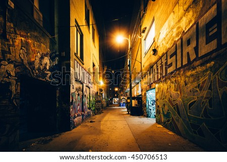 Graffiti Alley at night, in the Fashion District of Toronto, Ontario. - stock photo