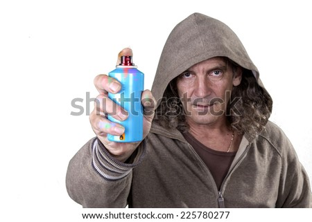 Graffiti artist in gray dress with hood spray paint for picture on the wall of  urban culture. Beautiful street art graffiti. Urban Contemporary Culture. Isolated on white background. selective Focus - stock photo