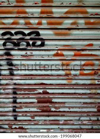 Graffiti Background on an Iron Gate - stock photo