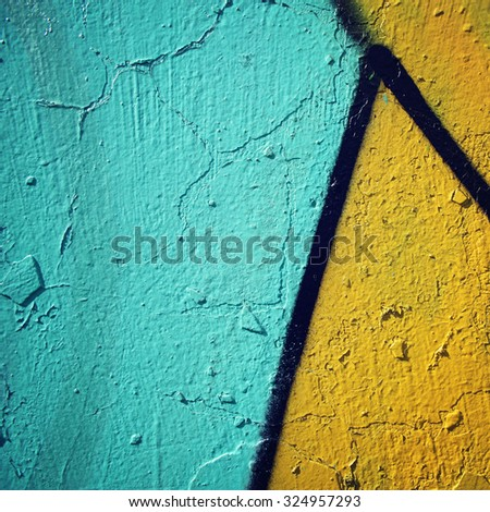 Graffiti closeup - retro photo. Color wall macro background  - vintage effect. Colorful paint on concreat surface - toned filter. - stock photo