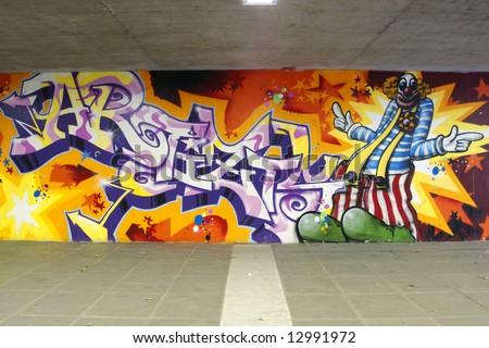 """Graffiti: clown and writing """"artizt"""" - stock photo"""
