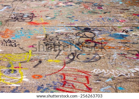 Graffiti covered sidewalk in New York City - stock photo