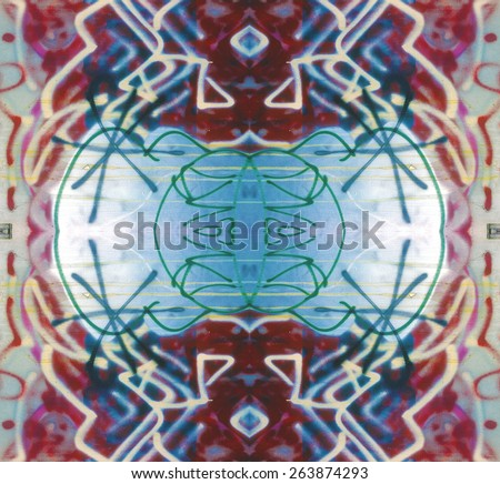 Graffiti Doodles medallion with a native, tribal allure, repeats seamlessly. - stock photo