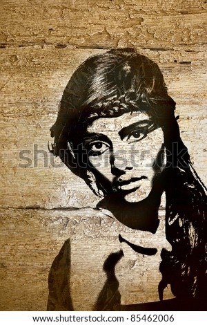 graffiti fashion illustration of a beautiful woman with long hair on wood wall texture with grunge effect - stock photo
