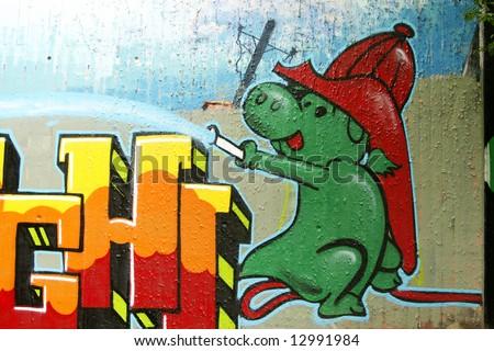 Graffiti: Grisu the dragon spilling water - stock photo