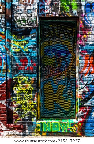 Graffiti on walls and door in Graffiti Alley, Baltimore, Maryland. - stock photo