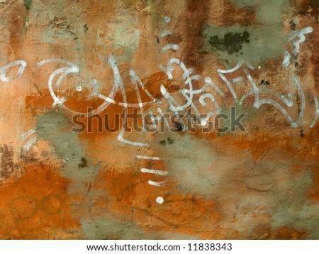 graffiti sprayed on a old wall - stock photo