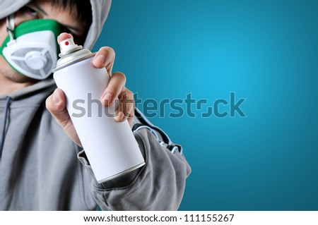 Graffiti young people on using spray paint - stock photo