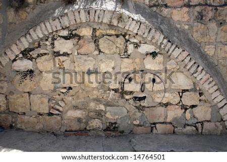 Graffity sprayed on a wall.Old city.Jerusalem. - stock photo