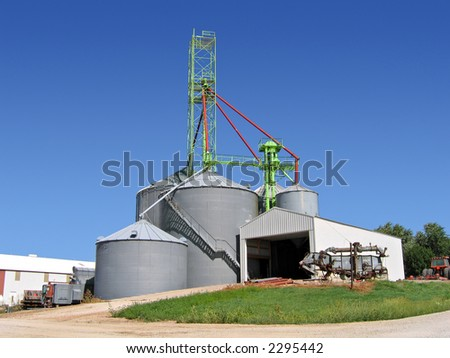 Grain bins in the Midwest - stock photo