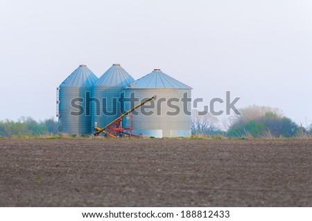 Grain Bins on the Prairie - stock photo