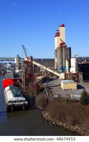 Grain elevator & barge. - stock photo