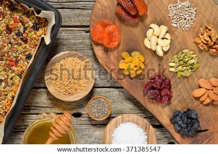 Grain free oat free paleo granola: mixed dried fruits, nuts, seeds, coconut flakes, chia and honey. Gluten free. Top view. - stock photo