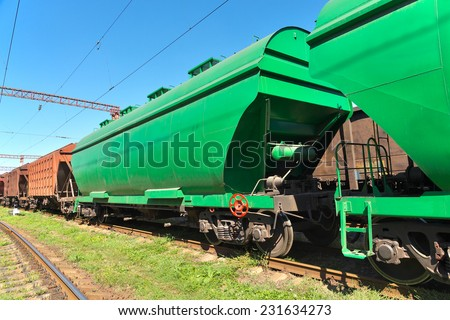 Grain hoppers on the railway track - stock photo