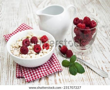 grain muesli with raspberries - a healthy breakfast - stock photo