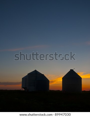 grain silo in sunset - stock photo