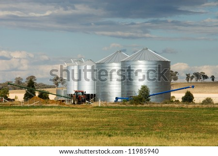 Grain silos on a farm in the Central West region of New South Wales, Australia - stock photo