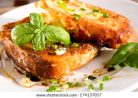 Grain toasts with green onions, basil, olive oil and vinegar - stock photo