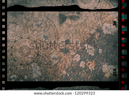 Grained film strip abstract grunge texture with paisley ornament - stock photo