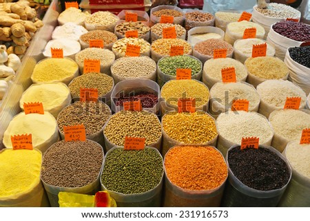 Grains and beans groceries in bulk bags at market - stock photo